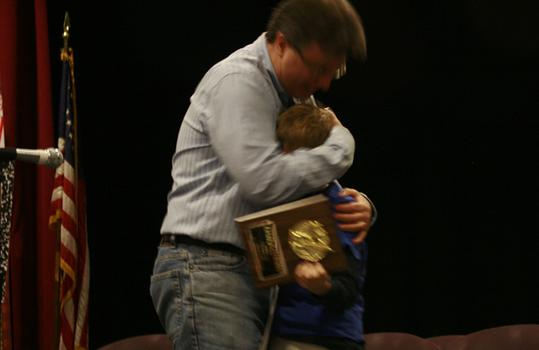The runner up gets a hug