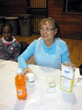 Cooking students learn about the health consequences of sugary drinks at a City Harvest class.