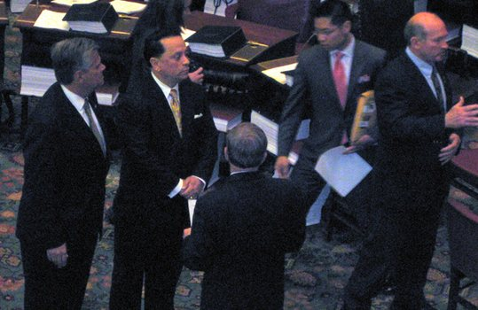 Senator Pedro Espada, Senator Dean Skelos, wait to be sworn in.