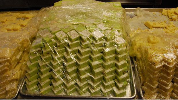 Diamond shaped pistachio burfi for sale at Maharaja Sweets.