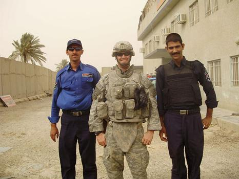 Another member of his squad also took this shot of Wilkens standing in between two Iraqi soldiers who were pushing seven feet tall.