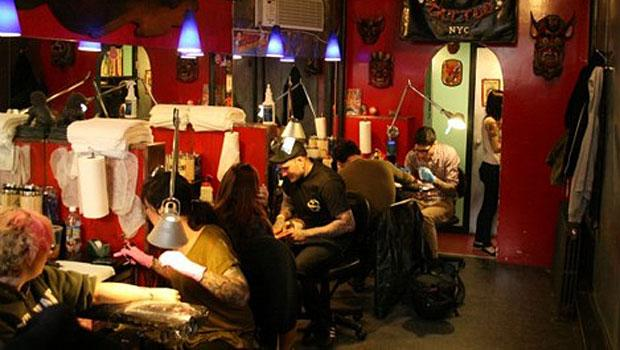 Daredevil Tattoo artists sat down for their first tattoo of the day. Most parlors giving out special Friday the 13th tats opened around noon and planned to close around 11 P.M.