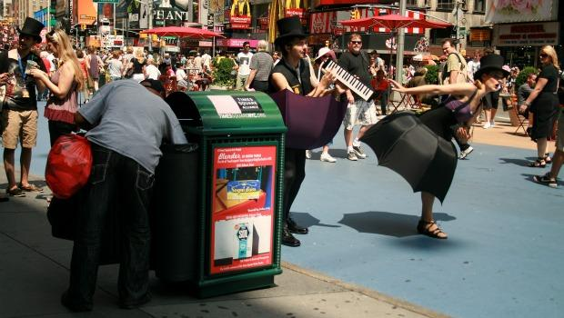 The photos can also be seen on trash cans amid the bustle of Times Square.