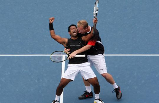 Leander Paes and Lukas Dlouhy celebrate match point.