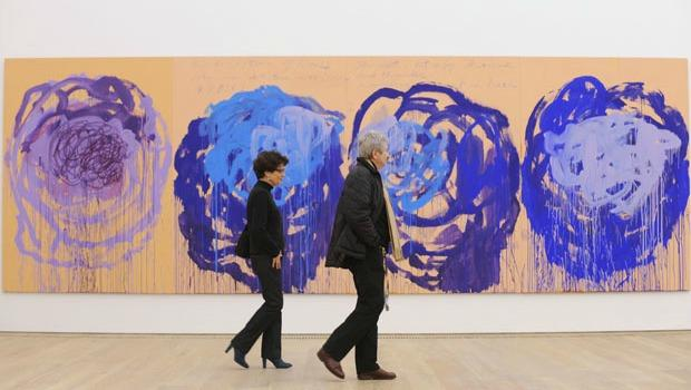 Visitors walk past US artist Cy Twombly's 'Rose' series at the Brandhorst museum in Munich December 15, 2009.