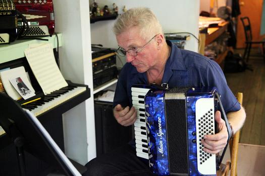 Walter Kuhr, owner of Main Squeeze, playing the accordion.