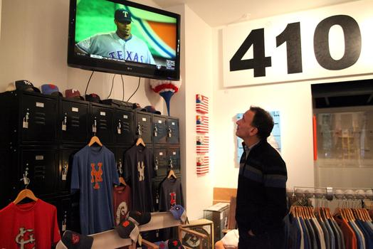 Jay Goldberg, CEO of Bergino, watches highlights of game six of the 2011 World Series.