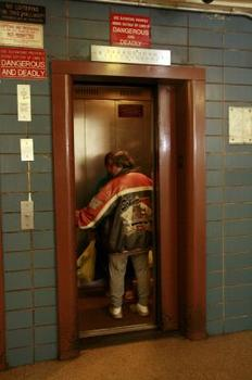 Residents ride the Chelsea Houses elevator