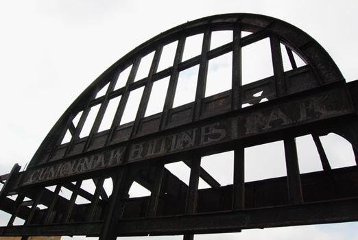 You can still see the ghost letters spelling out 'Cunard White Star' above the pier.