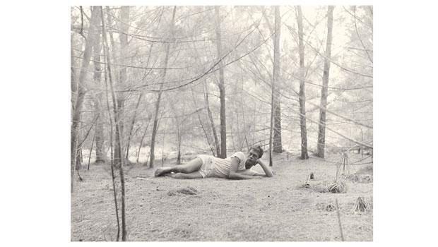 """Hujar made """"Paul Thek in the Woods"""" in 1957. The Gelatin-silver print measures 12 7/8"""" by 10 1/8""""."""