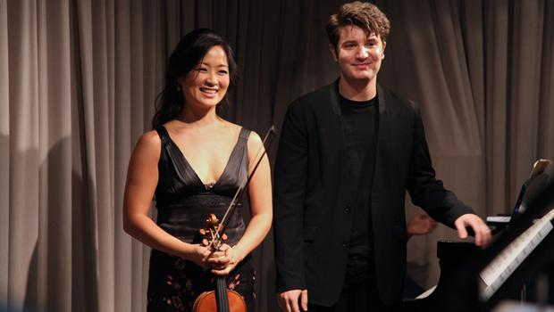 Violinist Chee-Yun and pianist Alessio Bax bowing following their live performance.