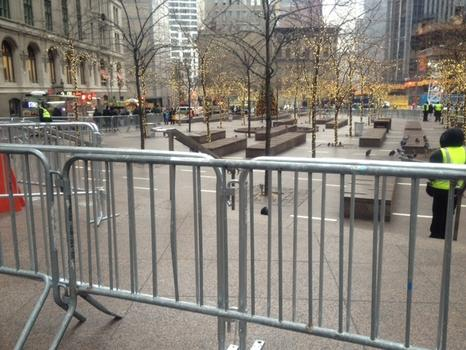 Barricades surround a near empty Zuccotti Park.