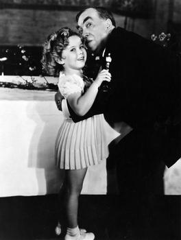 Shirley Temple, 1934 Special Award winner, with Irvin S. Cobb (The six-year-old actress starred in nine feature films in 1934).