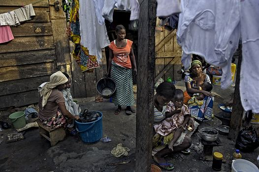 Kayayo girls in Ghana live in communal settings that require the least amount of rent, often near or on top of the city dump.