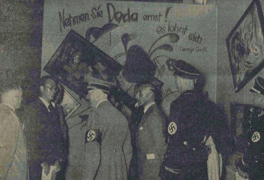 "Adolf Hitler and other Nazi officials (Hoffmann, Willrich, Hansen, and Ziegler) standing by the Dada wall at the ""Entartete Kunst"" (Degenerate Art) exhibition, July 16, 1937."