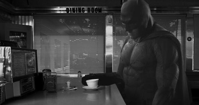 Sad Batman finishes his coffee.