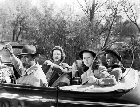 """Myrna Loy in """"Mr Blandings Builds His Dream House,"""" 1948. Myrna Loy leads husband Cary Grant and daughters Connie Marshall and Sharyn Moffett to their new country estate."""