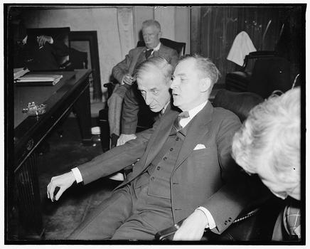 Maj. Gen. Smedley D. Butler gives a few off-the-record answers to Senator Homer T. Bone, (right) member of thr of the Senate Naval Affairs Committee, April 8, 1938.