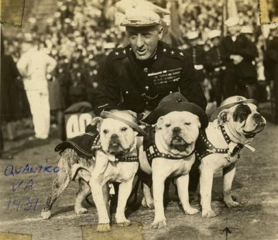 Maj. General Smedley D. Butler with marine mascots, Quantico, Virginia, 1931. Butler first introduced English bulldogs as Marine mascots in the 1920s.