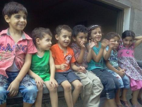 Children in Ghada Ageel's family singing.