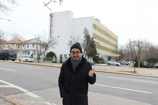 Writer Gary Shteyngart in front of the Kew Motor Inn, directly across from his family's first apartment in Queens.