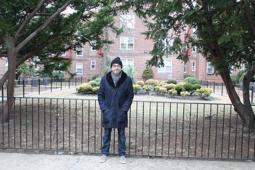 Writer Gary Shteyngart in the courtyard of his family's first apartment in Queens.