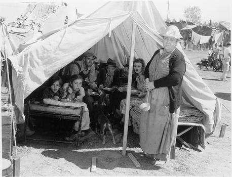 "Jane Darwell in ""The Grapes of Wrath,"" 1940. Ma Joad (Jane Darwell) leads her family (Henry Fonda, Russell Simpson, Doris Bowden seated in the rear) to California, the land of broken promises."
