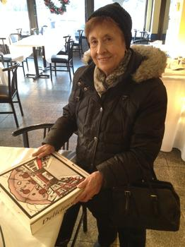 Angela Ricca, 83, picks up her pizza.