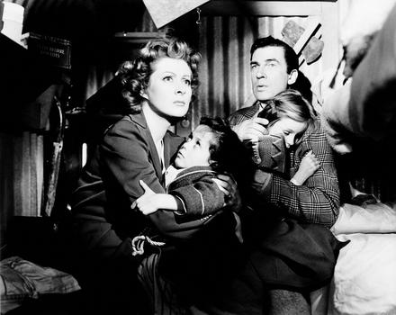 "Greer Garson in ""Mrs. Miniver,"" 1942. Greer Garson and Walter Pidgeon clutch their children (Christopher Severn and Clare Sanders) during an air raid."