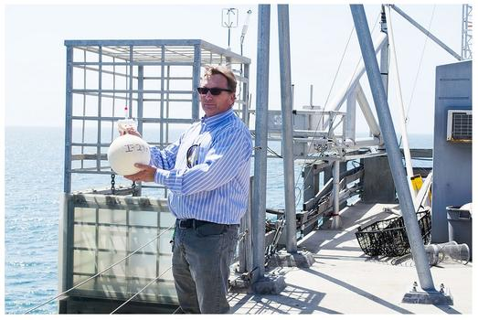 Scripps research scientist Tim Lueker with a CO2 collection flask at Scripps Pier, May 2013.