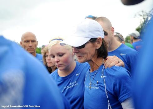 "A member of the running club ""Wear Blue: Run to Remember."""