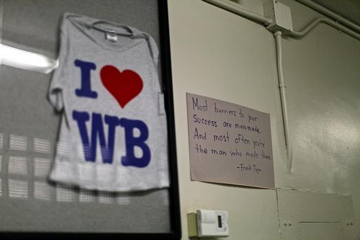 A shirt and sign hang at West Brooklyn Community High School.