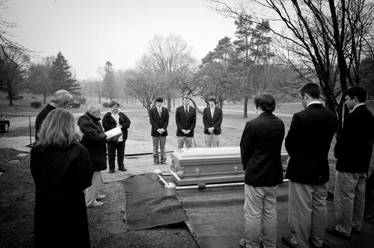 Saint Ignatius High School students in the Saint Joseph of Arimathea Pallbearers Ministry lead a funeral for a local resident in Cleveland, Ohio.