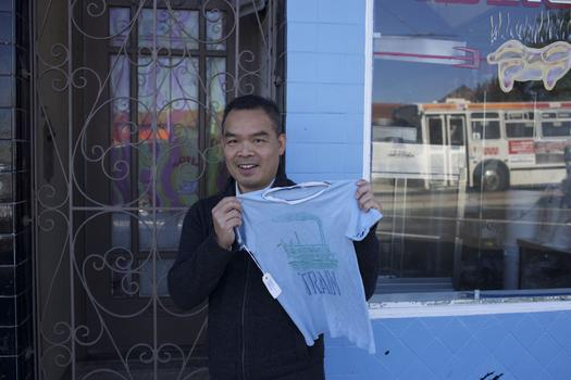 Andrew Lam outside his first apartment in America, in Daly City, just south of San Francisco. He's holding the shirt he was wearing as he escaped Saigon on April 28, 1975.