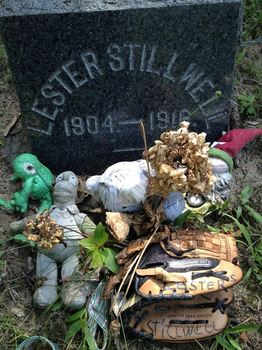 Tokens left by visitors to the grave of Lester Stillwell at Rose Hill Cemetery in Matawan, NJ.