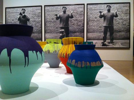 """Colored Vases"" and ""Dropping a Han Dynasty Urn"", both on display at the Brooklyn Museum's Ai Weiwei show, ""According to What?"""