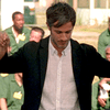 Rodrigo (Gael García Bernal) conducts in front of inmates at Rikers Island