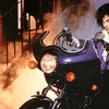 Prince, from the cover of his 1984 album 'Purple Rain'
