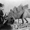 Charles R. Knight at work on a model of a stegosaurus in 1899