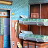 A detail view of Mar Cerdà's paper diorama illustrating an interior from 'The Darjeeling Limited'