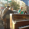 Kevin Shoemaker plays a piano in Union Square