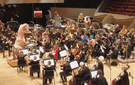 The Colorado Symphony embraced its inner nerd by letting this T-rex conduct the theme from 'Jurassic Park.'