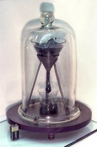 Picture of the Pitch Drop Experiment at the University of Queensland, with 9-volt battery for size comparison