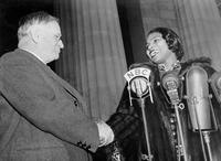 Marian Anderson is greeted by Harold L. Ickes, Secretary of the Interior, at the Lincoln Memorial