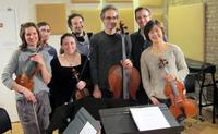 Brooklyn Philharmonic musicians pose with Alan Pierson, Jad Abumrad, and Tim Howard