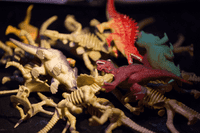 A pile of toy dinosaurs from Radiolab Live Apocalyptical