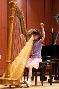 Harpist Lucy Ann Sotak, 10, rehearses Impromptu for Harp by Reinhold Glière.