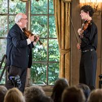 Violinist Glenn Dicterow coaches a student at the Music Academy of the West in 2013