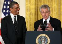 Former U.S. Sen. Chuck Hagel (R-NE) (R) speaks after U.S. President Barack Obama (L) nominated him to replace U.S. Secretary of Defense Leon Panetta as Defense Secretary