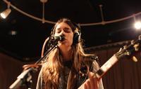 Middle sister Danielle Haim on lead guitar.